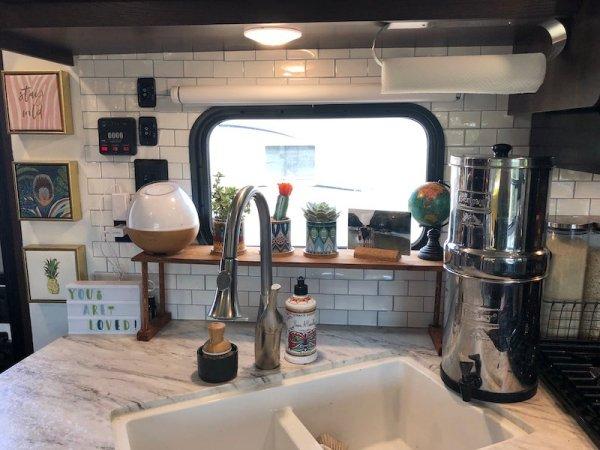 Shelf behind sink in camper kitchen