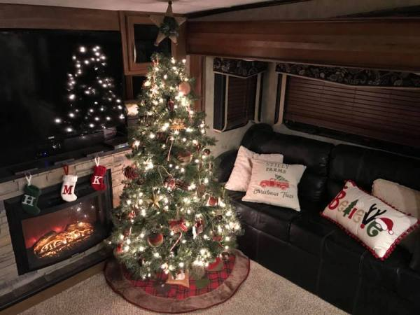 Large Christmas tree in camper by Megan Gregory