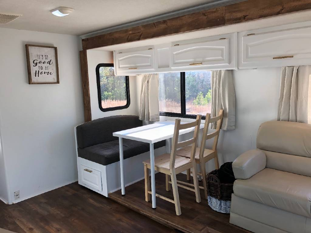 These RV owners removed the RV dining booth bench on one side and replaced with table and chairs