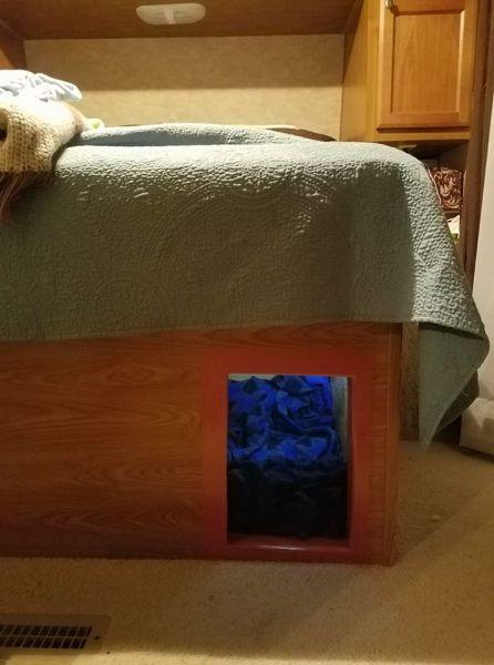 Dog door added under bed in fifth wheel RV