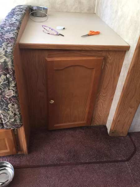 Cabinet in camper before removal