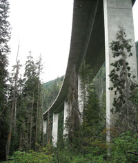 The Interstate 90 freeway stands above Franklin Falls, at left, and towers over the Denny Creek Trail that leads to the waterslides.