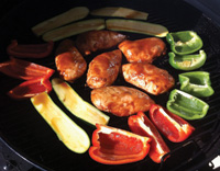 Marinades enhance flavors of green and red peppers, zucchini and chicken.