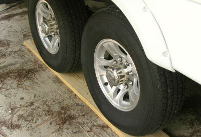 Also, make sure your tires are not resting on bare concrete or grass. Slip boards or plastic mats under your tires are ideal. Photo Courtesy ajlcal, irv2.com member