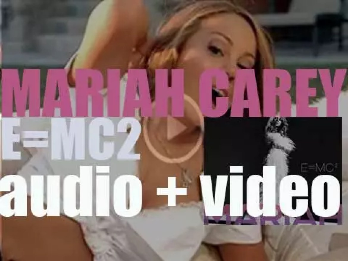 Mariah Carey releases 'E=MC²,'  her eleventh album featuring 'Touch My Body' (2008)