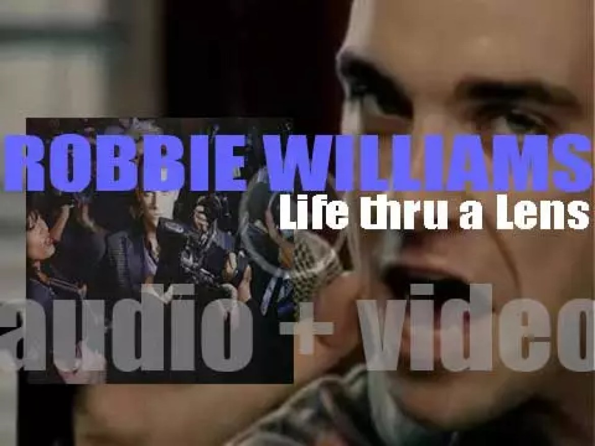 Robbie Williams releases his debut solo album : 'Life thru a Lens' featuring 'Angels' and 'Let Me Entertain You' (1997)