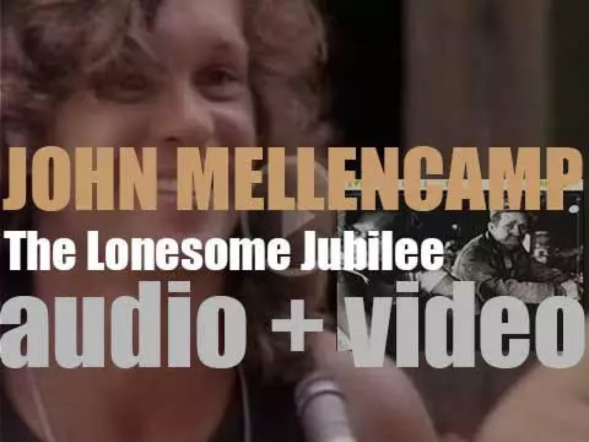 John Mellencamp releases his ninth studio album : 'The Lonesome Jubilee' featuring 'Paper in Fire' and 'Check It Out' (1987)