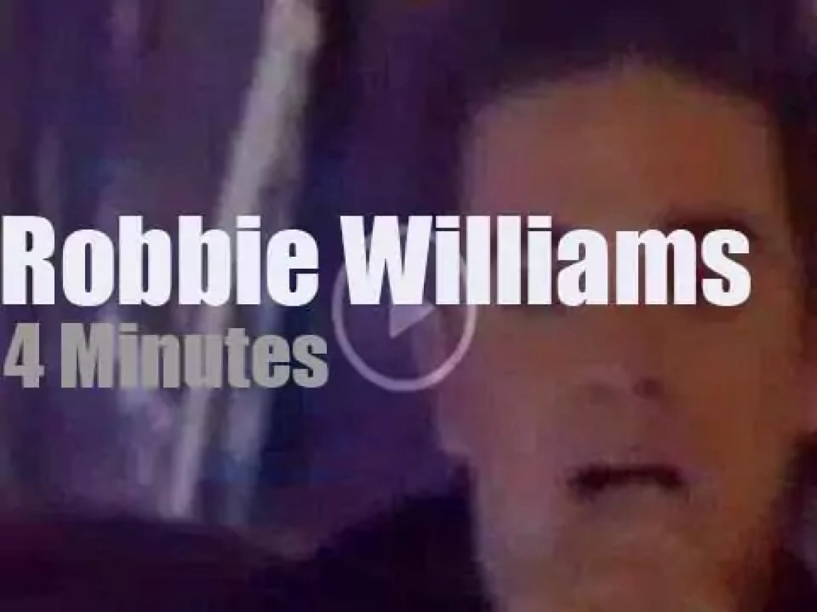On English TV today, Robbie Williams at 'Top Of The Pops' (1996)