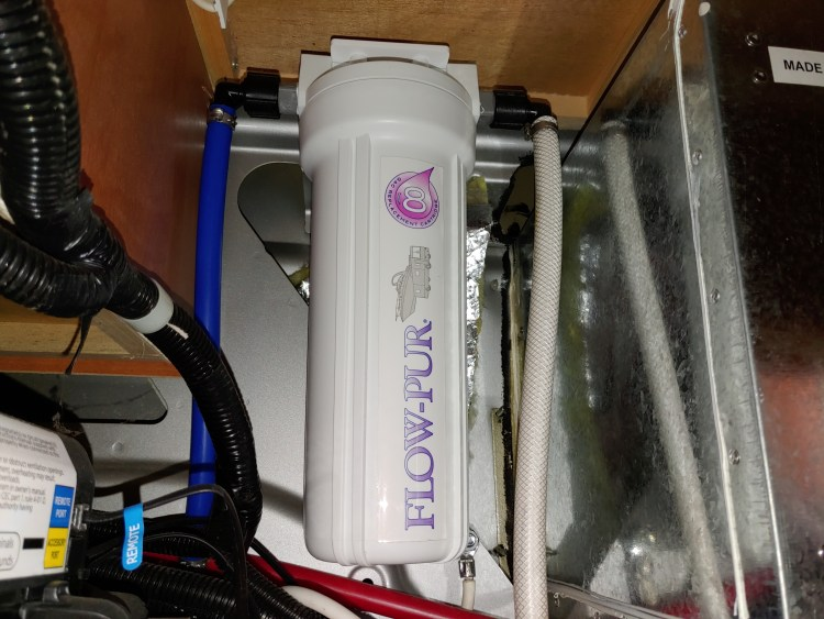 RV Flow-Pur water filter housing during RV inspection.