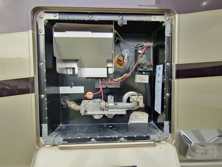 RV water heater during RV inspection