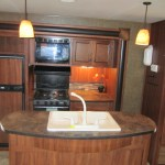 Inside travel trailer view of kitchen