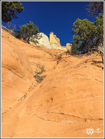 Climbing up the Chinle Formation. Echo Amphitheater. New Mexico