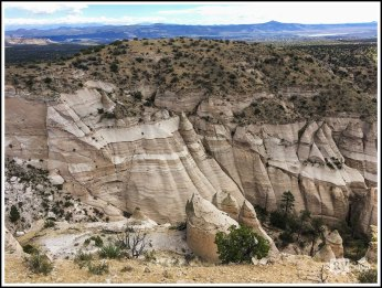 Vista of Slot Canyon with Cochiti Lake in the Distance. Kasha-Katuwe Tent Rocks National Monument. New Mexico