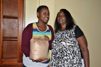 Leonia gives food to new RCEF student