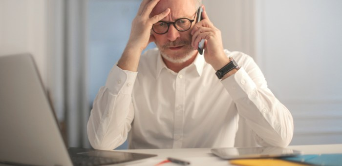 Businessman in a difficult situation, trying to solve a problem by calling someone