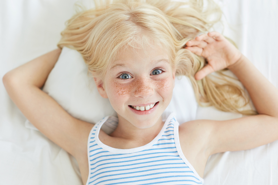 Cute Little Female Child With Blonde Hair, Blue Eyes And Freckle