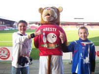 My friend Sam and me with the mascot, Gresty