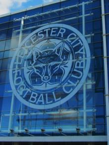 The large glass badge on the outside of the stadium