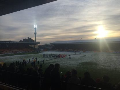 The players make their way on to the pitch, as seen from the press box