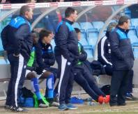 Mark Crossley, Chris Morgan and Danny Wilson look on from the touchline