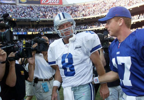 Troy Aikman exchanges pleasantries with former teammate Jason Garrett after Dallas' 19-14 loss in October of 2000. Though he passed for a season-high (at the time) 211 yards, Aikman's five interceptions led to the Cowboys' undoing.