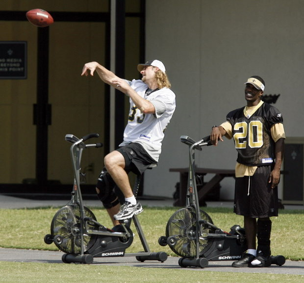Having played under him in New York and Dallas, Campbell thought it would be fitting to join Sean Payton in New Orleans for the 2009 season. But a severe knee injury in training camp ended not only his tenure with the Saints, but his NFL career as well. Here, Campbell throws a pass from a stationary bike during a training camp practice while Rudy Gay looks on.