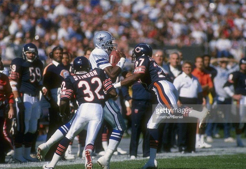 Cowboys WR Kelvin Martin catches a pass in front of two Chicago defenders.  Martin finished the game with 5 receptions for 63 yards.