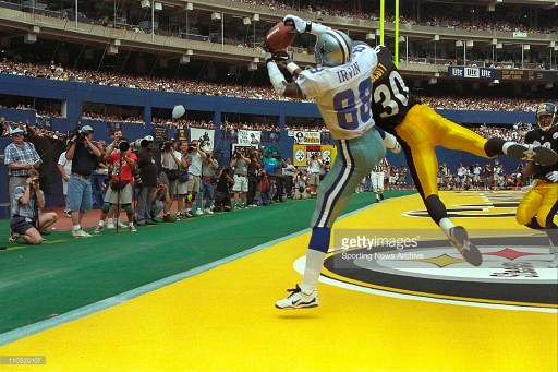 Michael Irvin was a menace to the Steelers all afternoon, catching 7 passes for 153 yards and two scores, including this third-quarter scoring grab over Chad Scott.