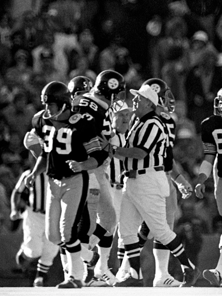 Game officials break up a minor scrum which broke out after Jack Lambert's throwdown of Cliff Harris during Super Bowl X.