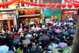 What appears to be a dragon dance down the main drag. Men in costume performed fluid dances and a series of bows as they entered many of the restaurants and shops. The idea (as I understand it) is to ward off evil spirits from the building while honoring with good luck, wisdom and long life.