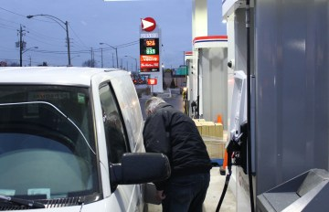 WINDSOR, ON. JANUARY 27, 2016. -- Windsorite Tim Beckham pumps his gas at the Pioneer gas station on Walker Rd. early in the monring on Wednesday, Janurary 27, 2016. Beckham is taking advantage of the already low gas prices that had been even lower throughout the week. (photo by -- Ryan Blevins)