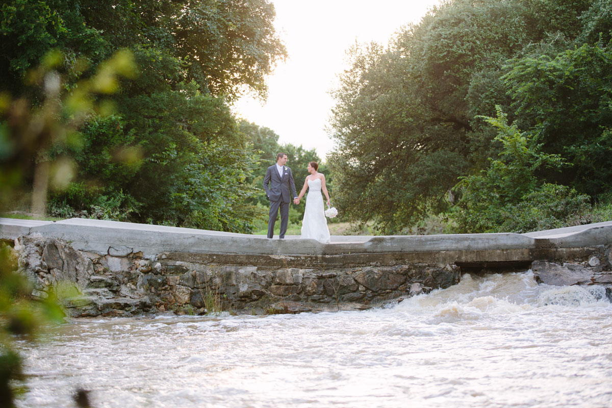 bride and groom on bridge at the orchard wedding venue