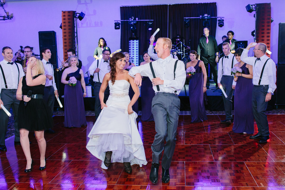bride and groom syncronized dance at live band wedding