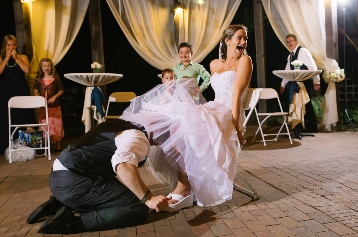 groom gets garter with teeth at chestnut square