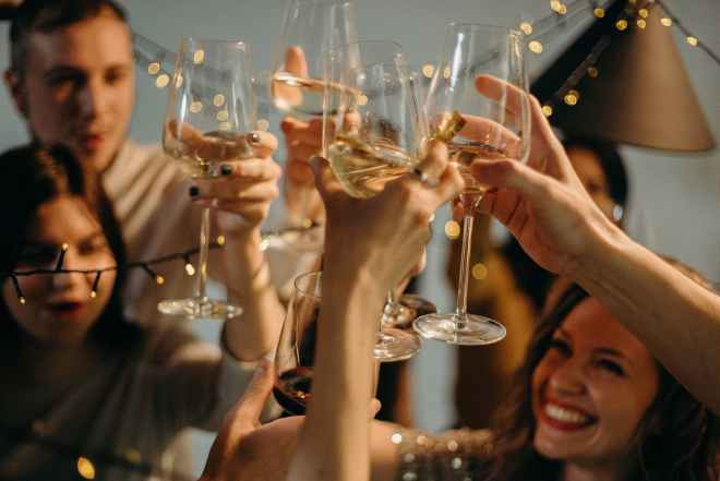 selective focus photography of several people cheering wine glasses