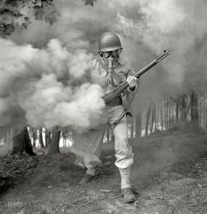 Sergeant George Camblair Practicing With His Gas Mask In A Smokescreen. Fort Belvoir, Virginia, 1942 (Original from shorpy.com)