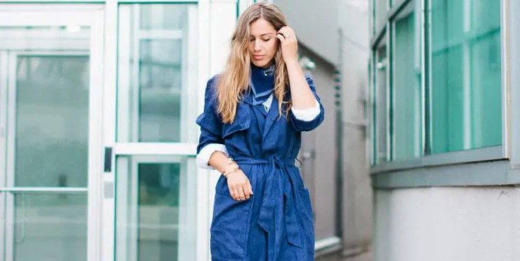 A lightweight trench is your go-to item. Photograph by Jen Eun. (what to wear hot humid rainy day)