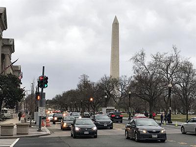 Washington Monument in traffic