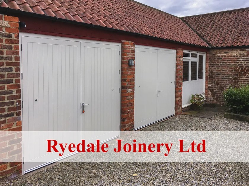 Large garage block with new doors and windows installed.