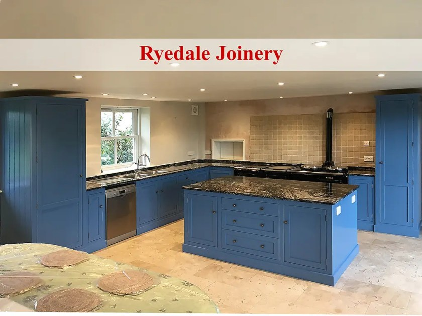 An image of a new kitchen with blue units and granite worktops.