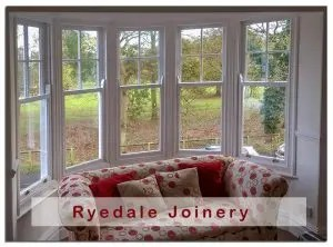 An image of a bay window containing five individual sash windows. The sash windows have been double glazed and upgraded by Ryedale Joinery.