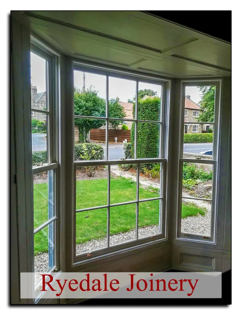 Internal view of classic Georgian sash windows within a bay.