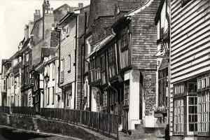 ALL SAINTS STREET HASTINGS - Looking up All Saints Street , Hastings, with its raised pavement and Tudor buildings. Limited edition etching by Colin Bailey