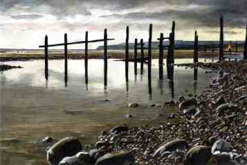 Coastal textures of Rye bay STICKS AND STONES Low tide at Winchelsea beach near Rye, the weather-beaten groynes stand in silhouette against the headland at Fairlight, East Sussex.