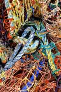 Coastal textures of Rye bay FRAID KNOT The multi coloured tangle of old fishing nets and ropes on the fishing beach on Hastings foreshore below the funicular railway and in front of the net huts