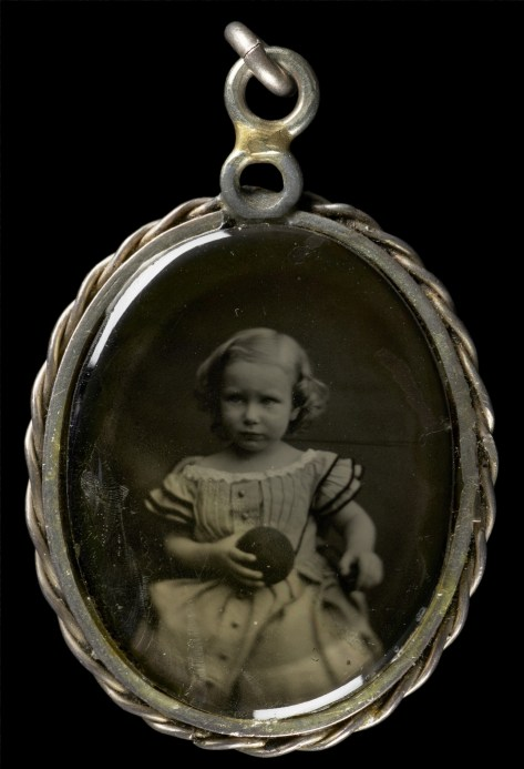 An ambrotype portrait of a very young girl.