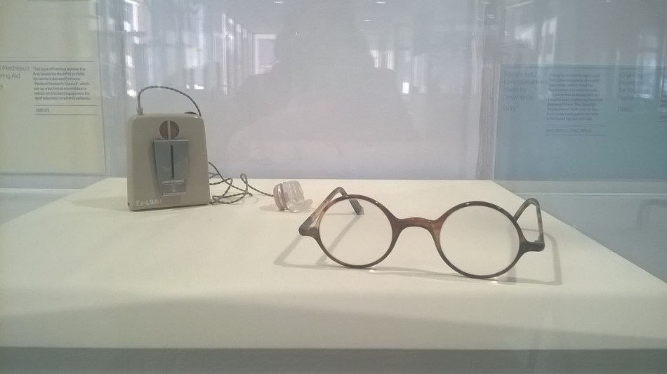 Example of a pair of tortoise shell frame spectacles 1940's and a hearing aid issued by the NHS in 1948.