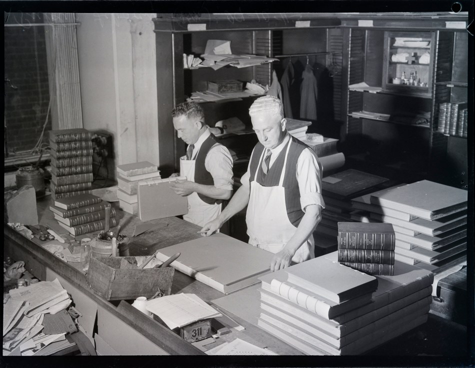 Book conservators in a traditional book bindery setting