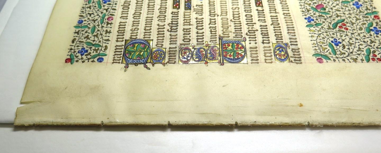 Folio of a manuscript under repair