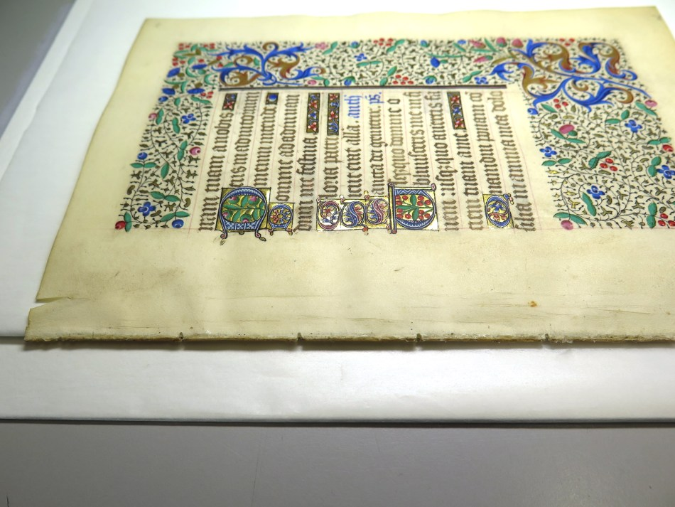Folio of a manuscript under repair
